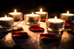 Six Romantic Tealights On Slate With Rose Petals And Leafs Stock Photos