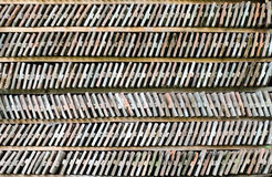Six rows of arranged bricks on a wood shelf. Stock Photos