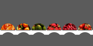 Six semicircles full of fruits and placed on a white ribbon. Collection of six semicircles full of different fruity textures: orange pieces, tangerines, limes Stock Photos