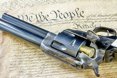 Six shooter pistil with a government document. Old time revolver with the constitution Royalty Free Stock Photos