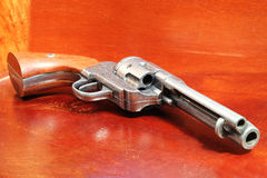Six Shooter. A replica of an old .44 six shooter revolver on a wooden cabinet Stock Photo