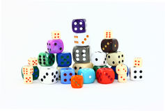 Six Sided Dice Assortment. A collection of traditional six sided dice in an assortment of sizes and colors photographed on a white background Royalty Free Stock Photos
