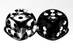 Six-sided dice, made of transparent plastic stock photo
