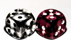 Six-sided dice, made of transparent plastic. Macro, isolated on white background Royalty Free Stock Photo