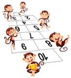Six singes jouant le jeu de marelle Images stock