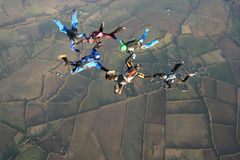 Six skydivers. Five skydivers doing formations high up in the air Stock Photo