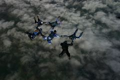 Six skydivers building a formation. High up in the air Royalty Free Stock Photography