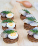 Six small canapes with herring Royalty Free Stock Images