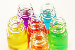 Six small opened glassy bottles of aromatic oils Royalty Free Stock Photos