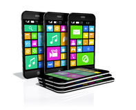 Six smartphones with a variety of software applications. Stock Image