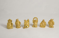 Six Smiling Buddha figures Stock Images