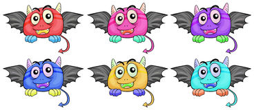 Six smiling monster heads with wings Royalty Free Stock Images