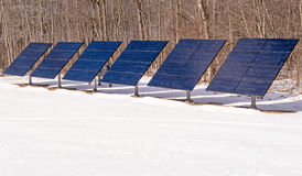 Six solar panels in snow Stock Image