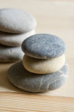 Six spa zen stones stacked on a wood background Stock Photos