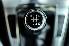 Six speed gear shifter. In a brand new car (DoF Royalty Free Stock Image