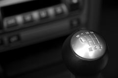 Six speed gear stick. German sportscar interior with six speed gear stick in focus Royalty Free Stock Image