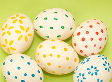 Six spotted easter eggs on green background Royalty Free Stock Photo