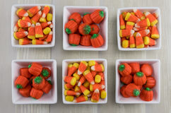 Six Square Bowls of Candy Corns and Pumpkins Royalty Free Stock Photos