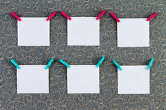 Six square tags with clothespins attached Stock Images