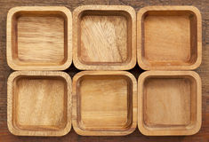 Six square wooden bowls Royalty Free Stock Photos