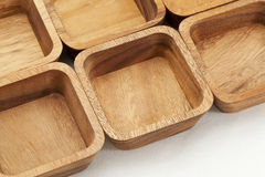 Six square wooden bowls Royalty Free Stock Image