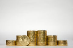 Six stacks of coins increasing height symmetrically on a white background, pockmarked stands on the edge of the Russian 10 ruble c. Oin Stock Photos