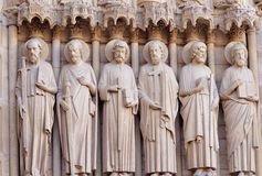 Six statues of the apostles on the western facade of Notre Dame, Paris, France royalty free stock photography