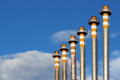 Six of steel chimney and blue sky Royalty Free Stock Photos