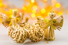 Six straw christmas balls and two angels Stock Images