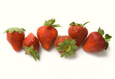 Six strawberries. A white background royalty free stock photography