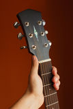 six-string acoustic guitar on a red background Stock Photography
