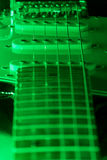 A six string electric guitar with green light Stock Photo