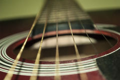 Six-string guitar. Strings, rosette and soundboard of the guitar royalty free stock photography