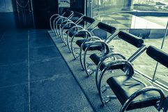 Modern steel chairs lined up in a room royalty free stock photo