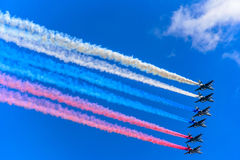Six Su-25 assault aircrafts leaving smoke as tricolor Russian flag at the rehearsal for the Victory Day military parade Royalty Free Stock Images