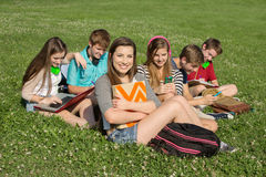 Six Teens Studying Outdoors Royalty Free Stock Images