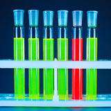 Six test tubes, one red Stock Image