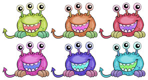 Six three-eyed aliens Royalty Free Stock Images
