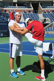 Six times Grand Slam champion  Novak Djokovic stretching before practice for US Open 2013 at National Tennis Center Stock Photos