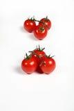 Six tomates-cerises sur le blanc Photo libre de droits