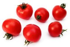 Six tomatoes on a white background Stock Photo