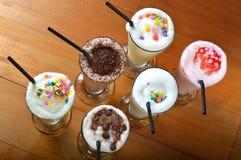 Six types de boisson de milkshake Photographie stock