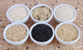 Six varieties of uncooked rice Royalty Free Stock Photography