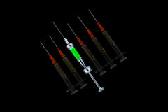 Six various syringes in row Stock Photo
