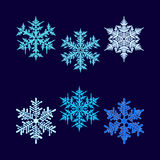 Six vector beautiful hex-shaped snowflakes. Six beautiful snowflakes on a dark blue background Royalty Free Stock Photography
