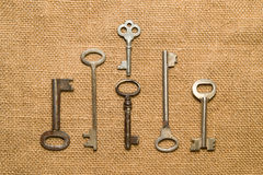 Six very old keys  on old cloth Royalty Free Stock Photo