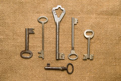 Six very old keys  on old cloth Stock Photo