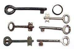 Six vieux clés et porte-clés rouillés Images libres de droits