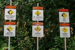 Six warning signs at Ke'e Kee State Beach Park, Hawaii Stock Photography