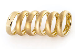 Six wedding rings in a line Royalty Free Stock Images